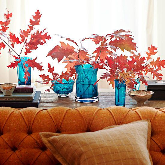 Fall DIY Budget Decorating bright vases with leaves
